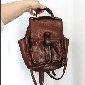 Vintage Wilson's Leather Bucket Mini Backpack